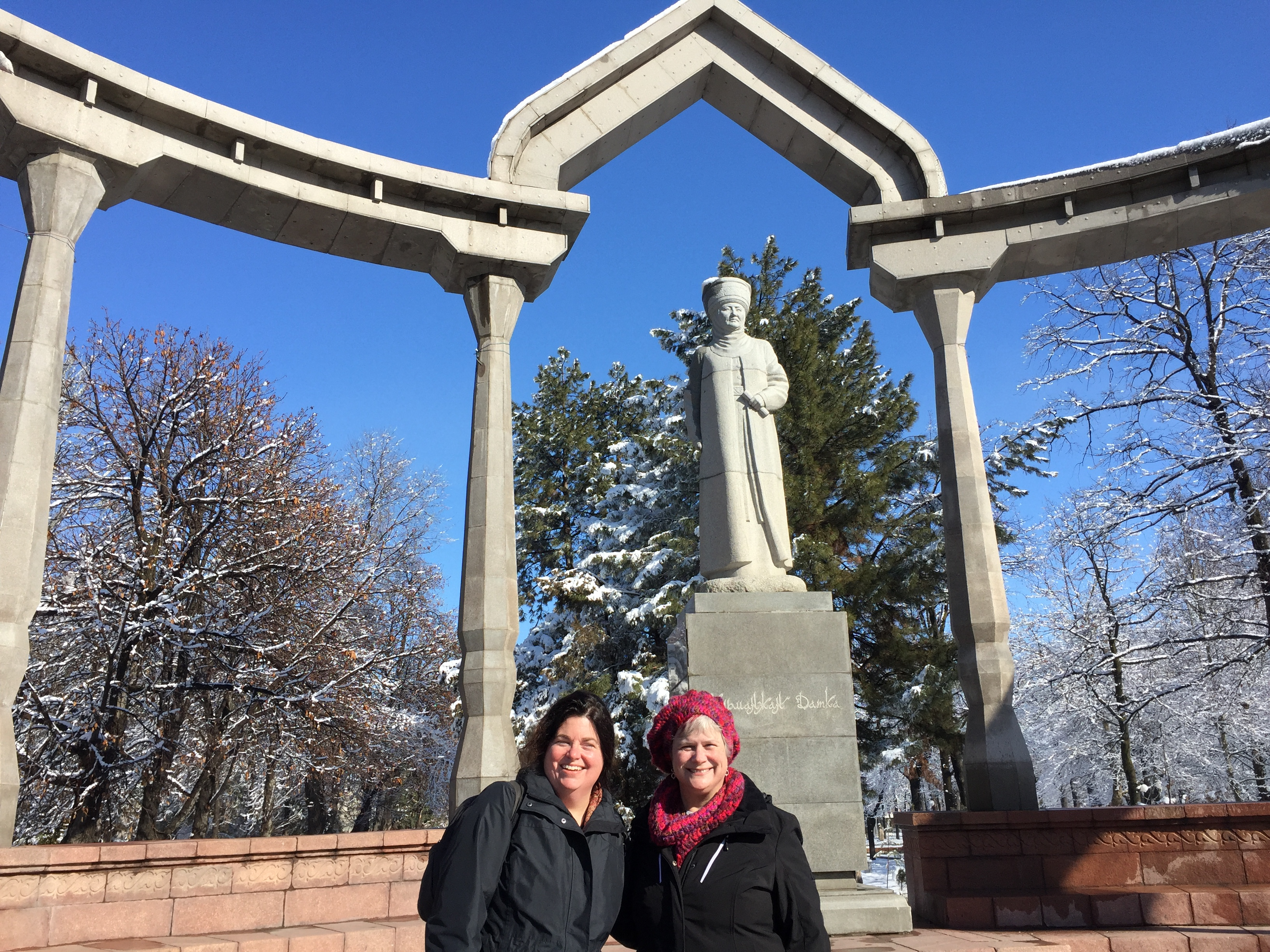 TechWomen Kyrgyzstan Delegation 2017 Katy Dickinson and IdaRose Sylvester with Kurmanjan Datka statue Bishkek