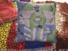Sierra Leone woman batik pillow and embroidered clothes, July 2017