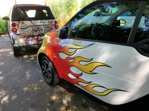 Katy Dickinson 2009 and 2017 SmartCars with wraps