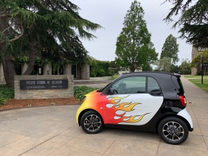 Katy Dickinson flaming 2017 SmartCar at Pacific School of Religion, Berkeley