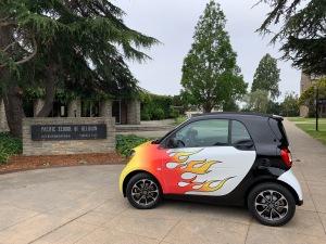 Katy Dickinson flaming 2017 SmartCar at Pacific School of Religion, Berkeley