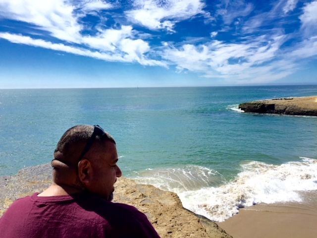 Daniel Vega Martinez 1969-2021, at beach, by Peggy Bryan